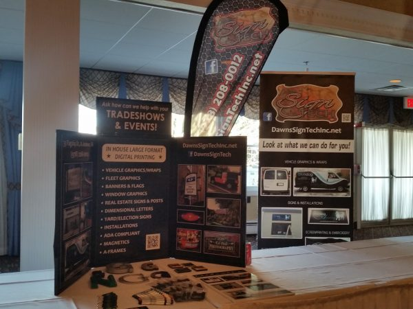 Tradeshow set up with retractable banner, flutter flag and tabletop display