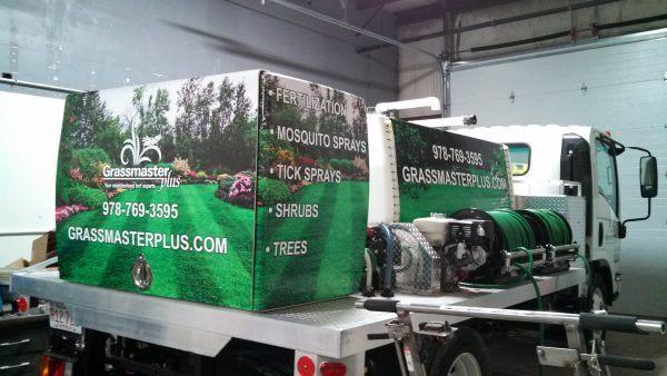 Grassmaster Plus Georgetown partial wrap of tanks